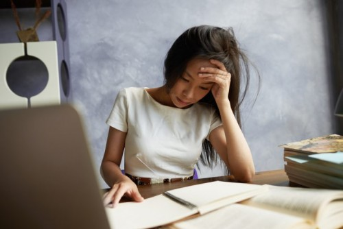 Frustrated-Asian-Lady-at-desk-768x513.jpg